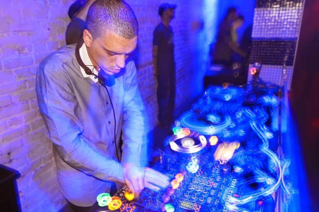 DJ Playing dubstep in a club.