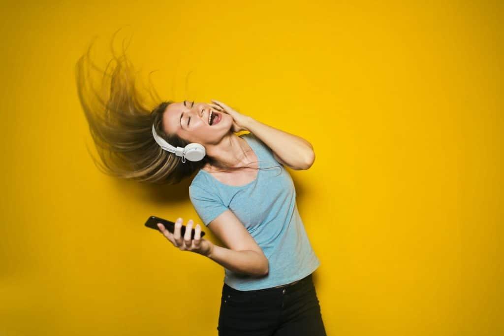 A girl enjoying her music.